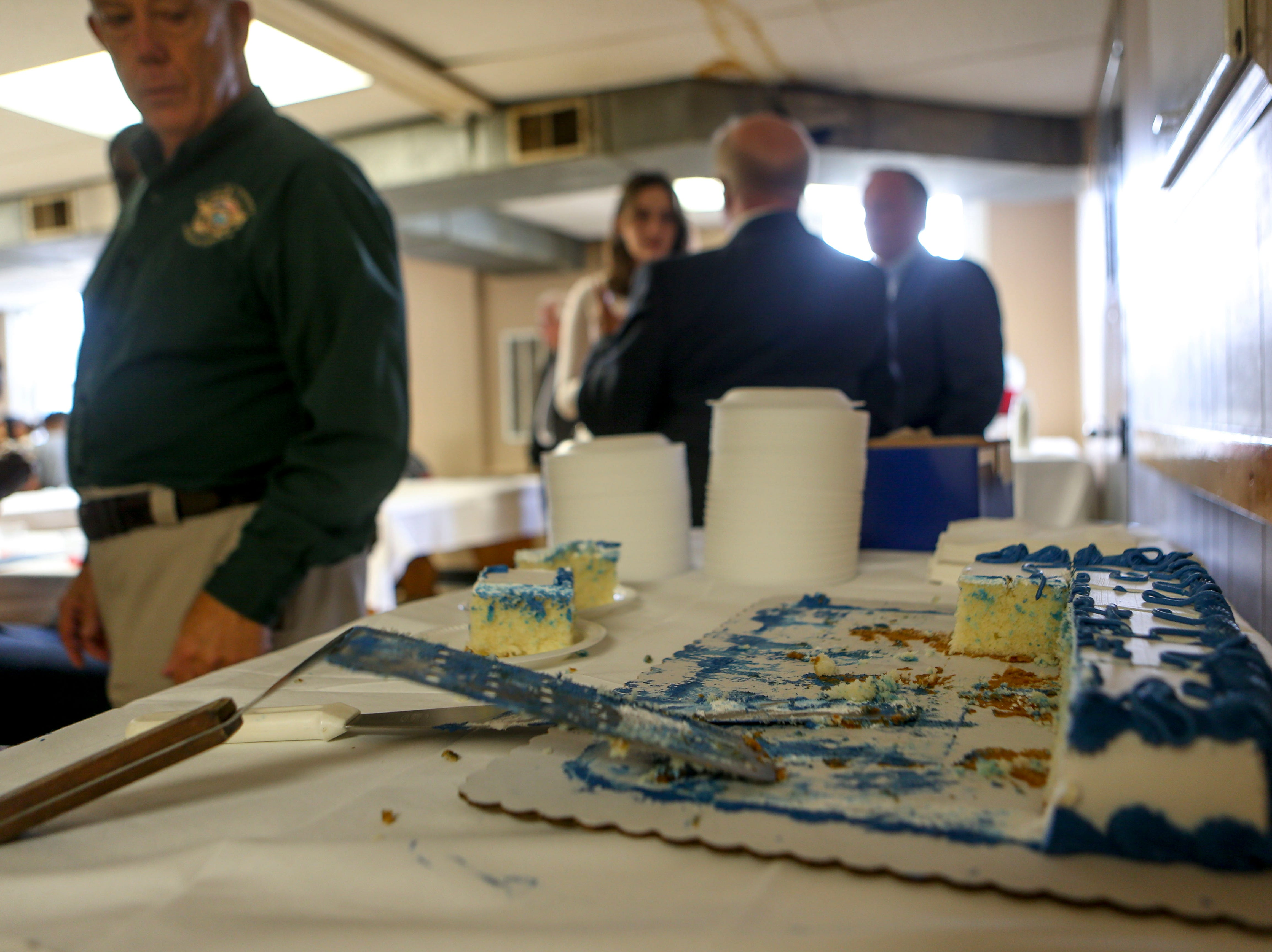 A cake to celebrate the prisoners accomplishment can be seen nearly completely eaten during a graduation ceremony for the InsideOut Dad program at Madison County Penal Farm in Jackson, Tenn., on Thursday, Oct. 4, 2018.