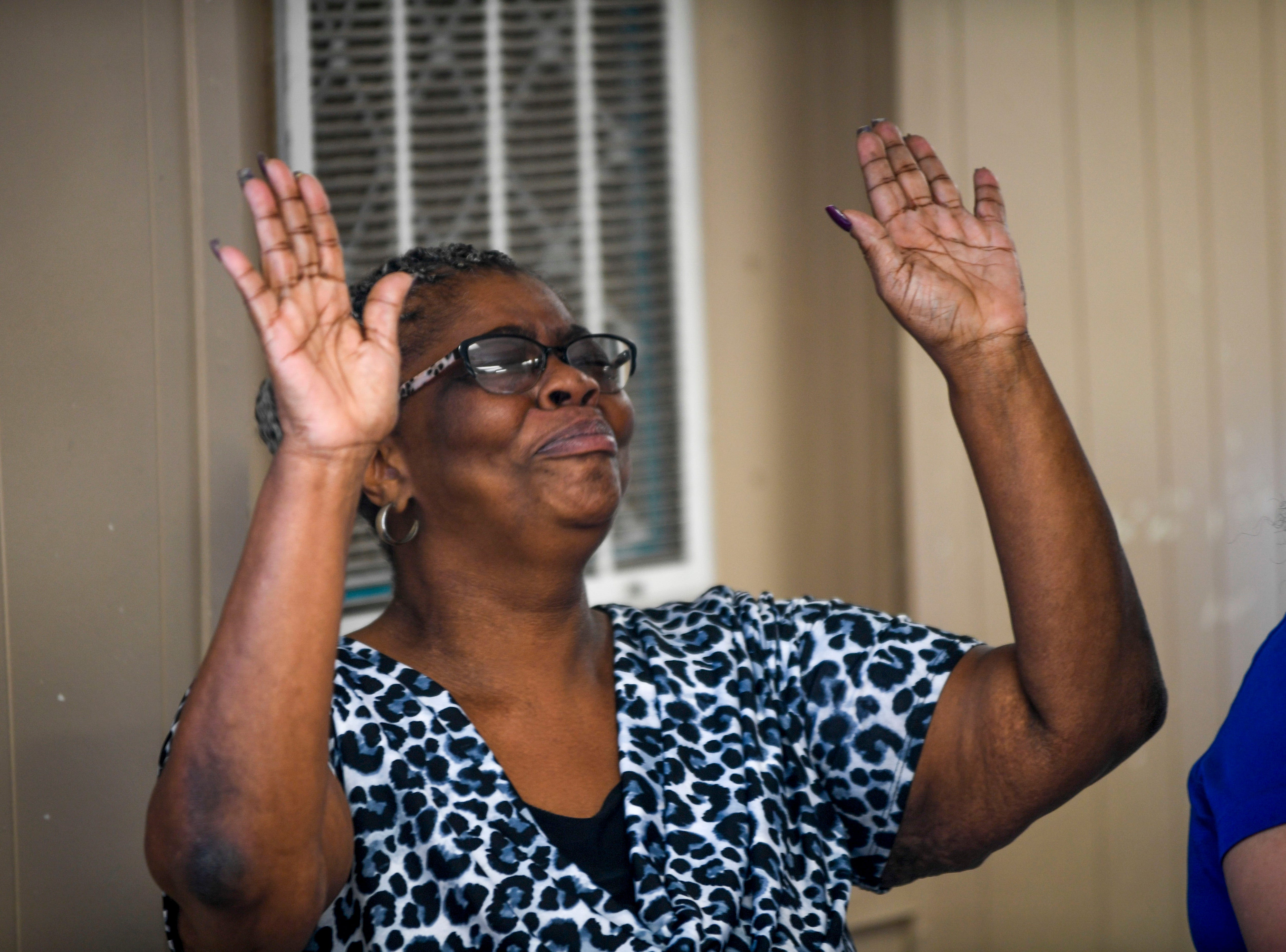 Jimmie Ruth Douglas, mother of Carey Demoss, raises her hands in celebration for her son during a graduation ceremony for the InsideOut Dad program at Madison County Penal Farm in Jackson, Tenn., on Thursday, Oct. 4, 2018.
