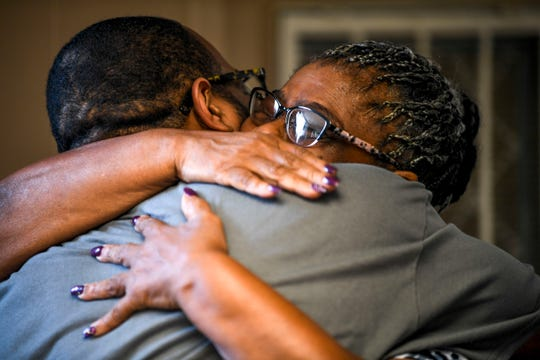 Jimmie Ruth Douglas, right, embraces her son Carey Demoss during a graduation ceremony for the InsideOut Dad program at Madison County Penal Farm in Jackson, Tenn., on Thursday, Oct. 4, 2018.