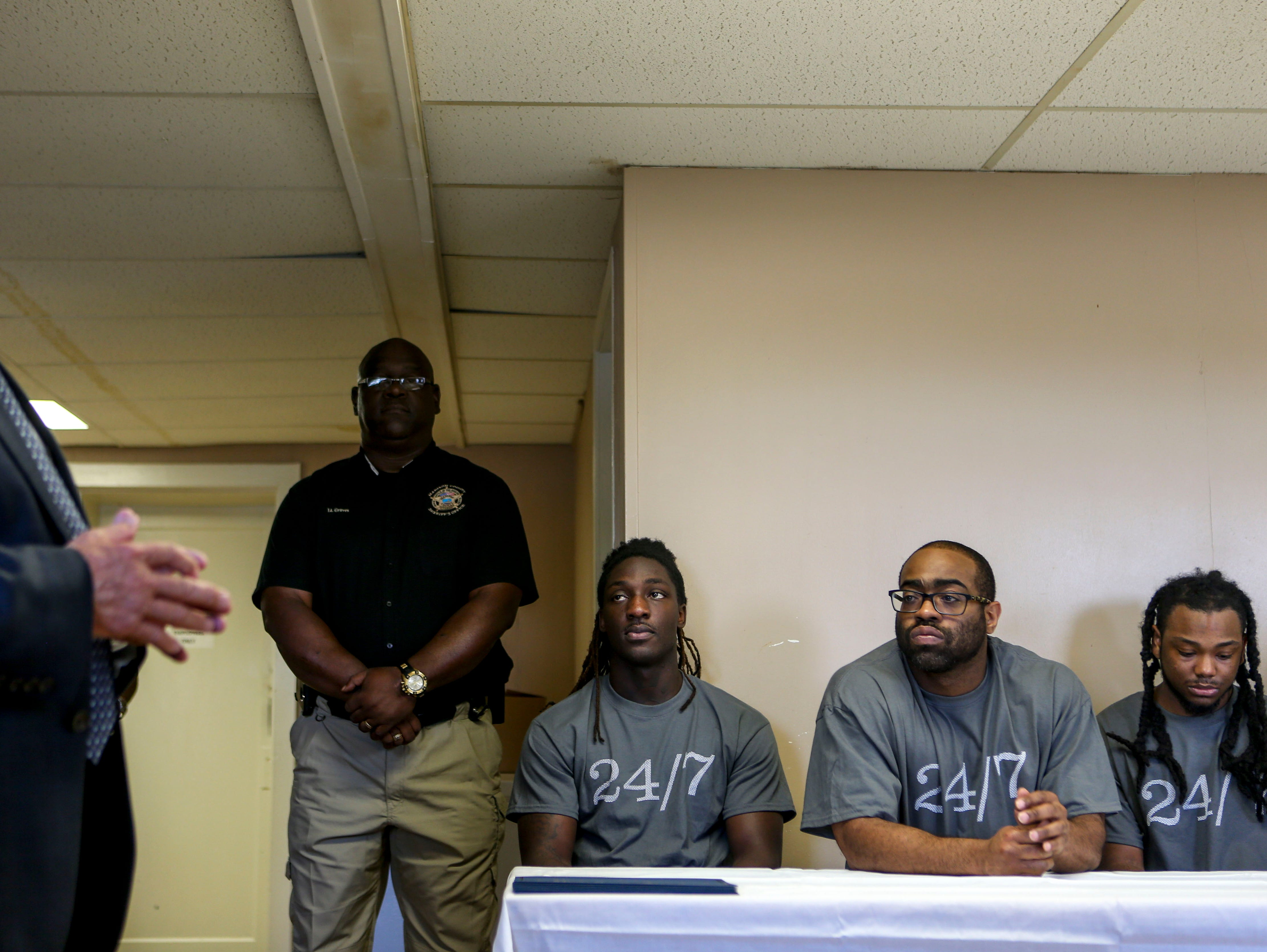 Jarnakin Brown, left, Carey Demoss, center, and Jarrett Wilson, right, listen to program directors speak in support of their completing the InsideOut Dad program at Madison County Penal Farm in Jackson, Tenn., on Thursday, Oct. 4, 2018.