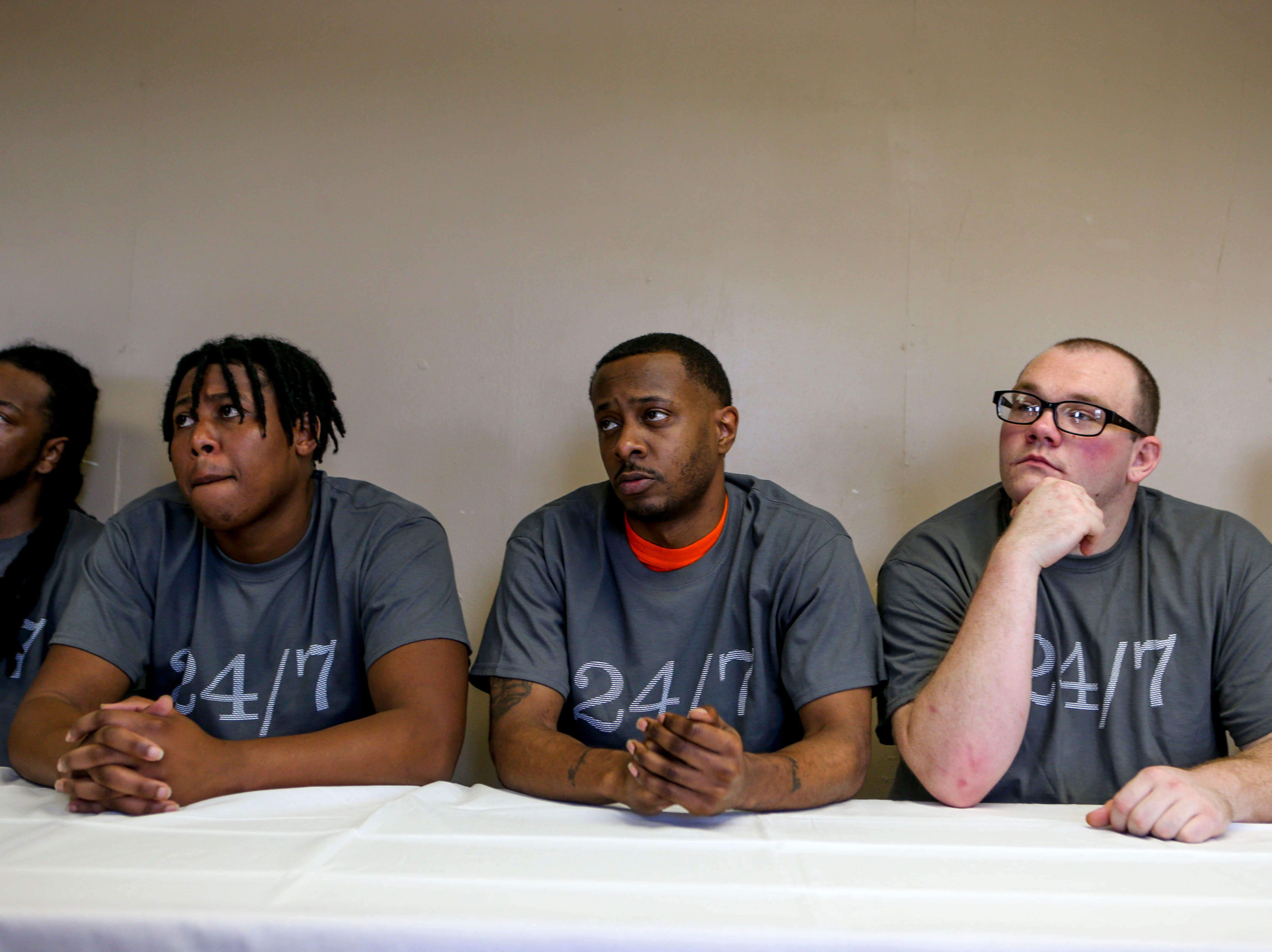 Nikolas Rhea, left, Devin Whitaker, center, and Dustin Alexander, right, sit and listen to program directors speak on their behalf during a graduation ceremony for the InsideOut Dad program at Madison County Penal Farm in Jackson, Tenn., on Thursday, Oct. 4, 2018.