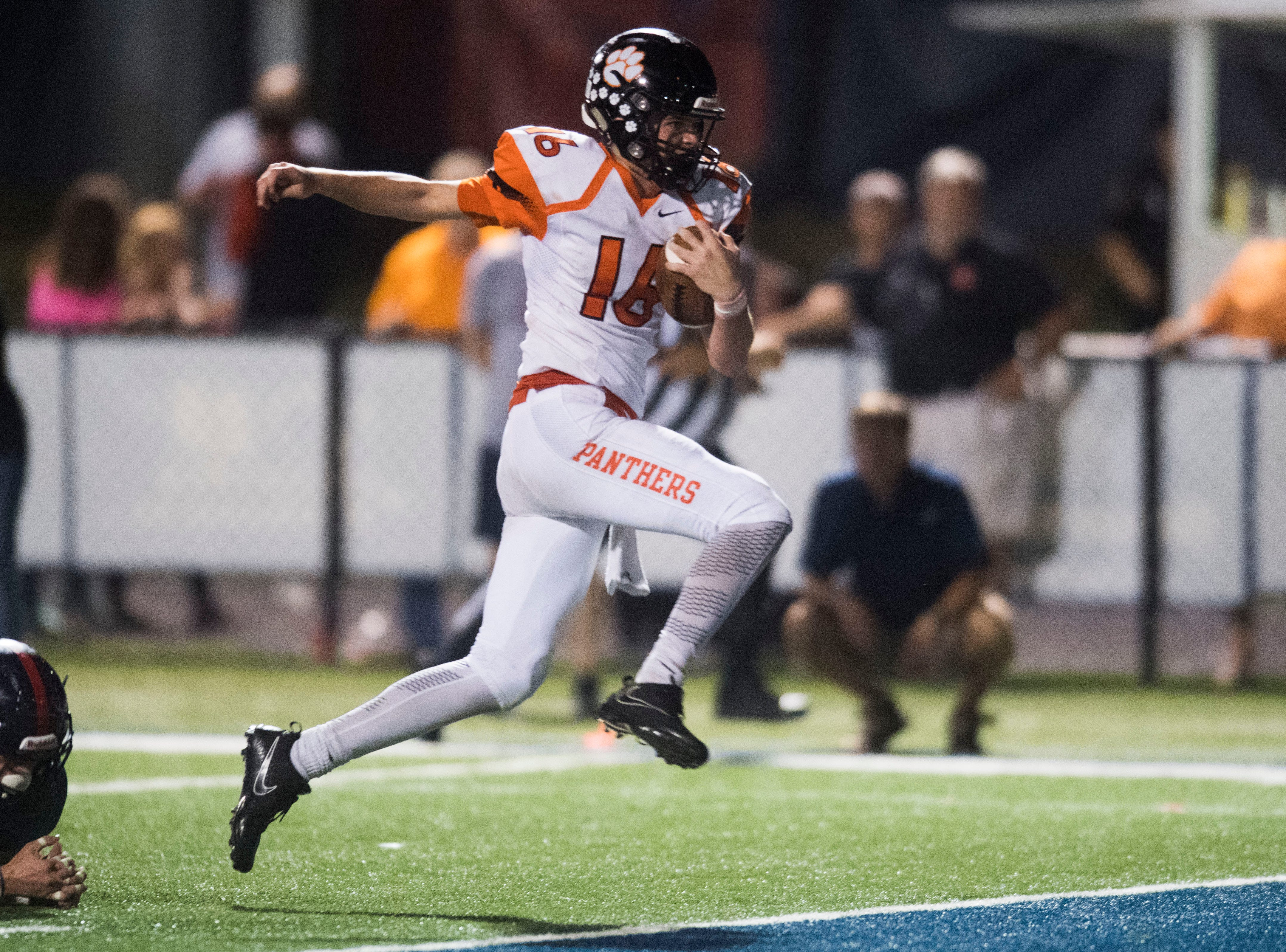 Powell's Walker Trusley (16) runs into the end zone for a touchdown during a game between West and Powell at West, Friday, Oct. 5, 2018. Powell defeated West 36-21.