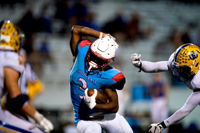 "Austin-East's Isaiah Ligon (3) dodges the Gatlinburg-Pittman defense during a game between Austin-East and Gatlinburg-Pittman at George ""Dusty"" Lennon Stadium in Knoxville, Tennessee on Friday, October 5, 2018."