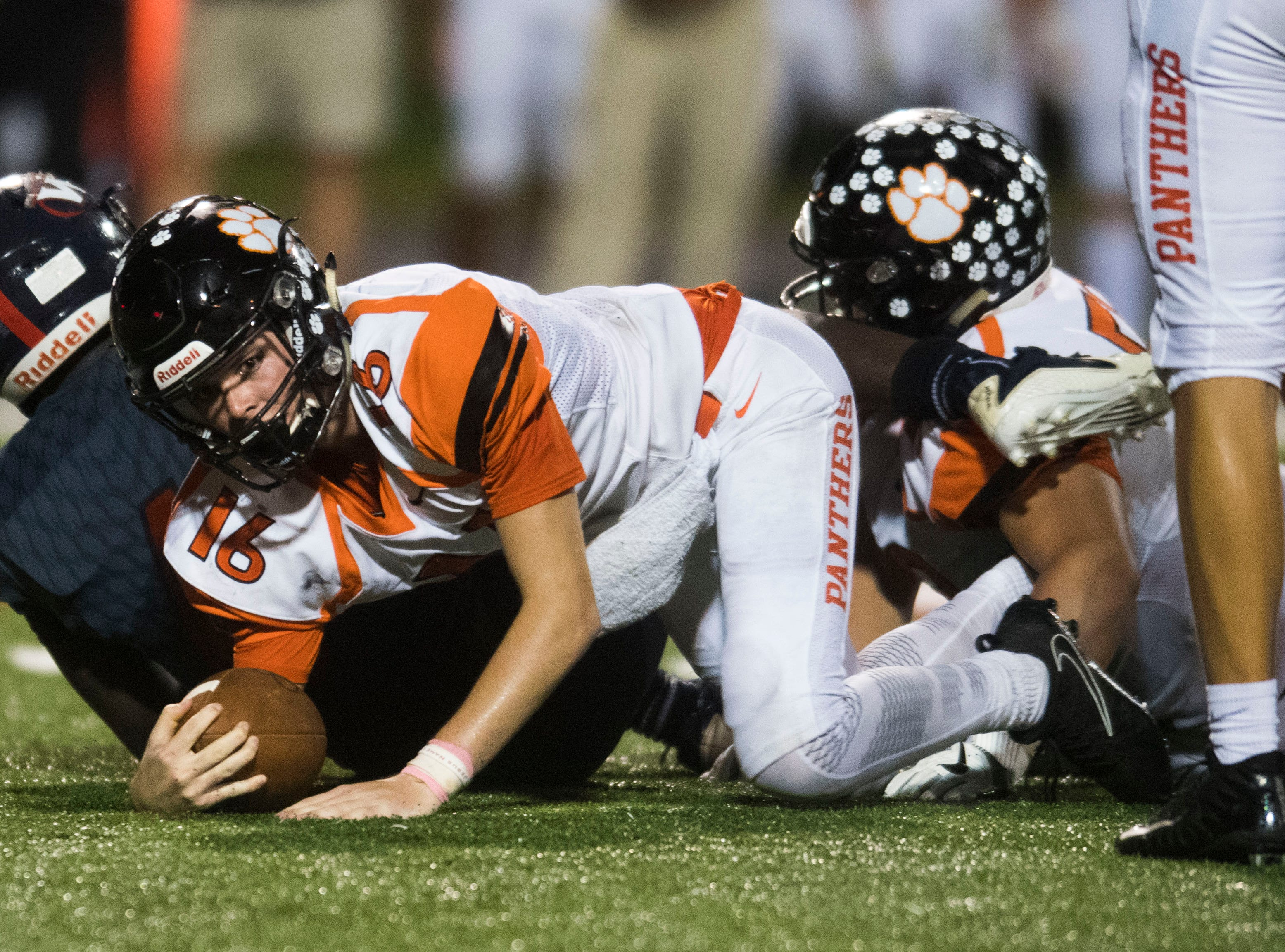 Powell's Walker Trusley (16) falls to the ground during a game between West and Powell at West, Friday, Oct. 5, 2018. Powell defeated West 36-21.
