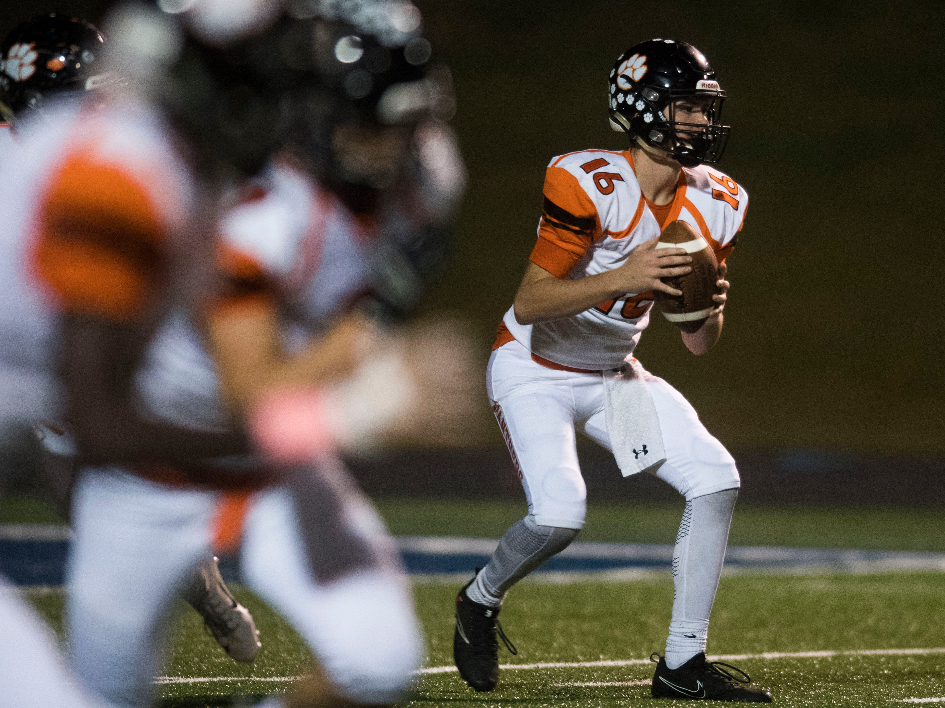 Powell's Walker Trusley (16) looks to pass during a game between West and Powell at West, Friday, Oct. 5, 2018. Powell defeated West 36-21.