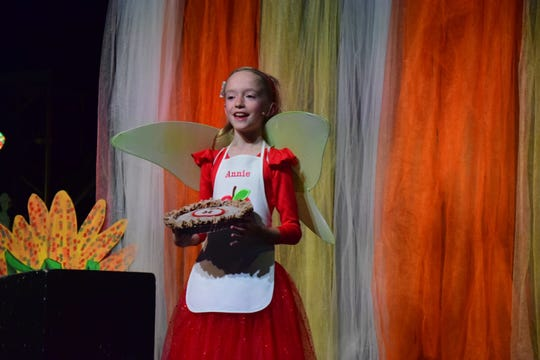 """Lauren Thornton, 10, wins first place in grade 5 for her story """"Annie and the Apple Pie Fairy."""""""