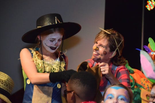 Sixth-grader Sarah Molitor gets a word of encouragement from Grace Christian Academy director Tonya Wilson at the Storytelling Festival on Friday, Oct. 5.