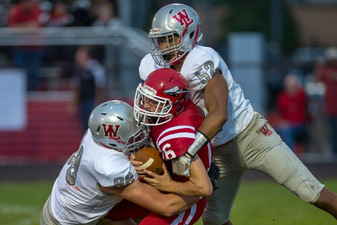 Even with future Division I defensive linemen George Karlaftis (88) and Tavion Woodard (52), Tipton quarterback KJ Roudebush will be a tough test for West Lafayette.