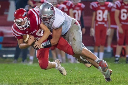 George Karlaftis serves up a punishing sack in the first half of the West Lafayette at Twin Lakes football game.