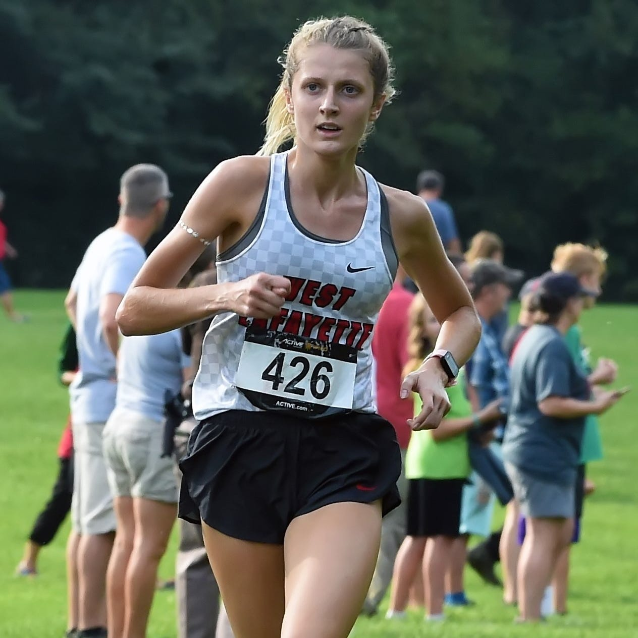 Mary Schultz leads the girls into the gate for West Lafayette Saturday in the IHSAA Harrison Cross Country Sectional at the Tippecanoe Amphitheatrer.