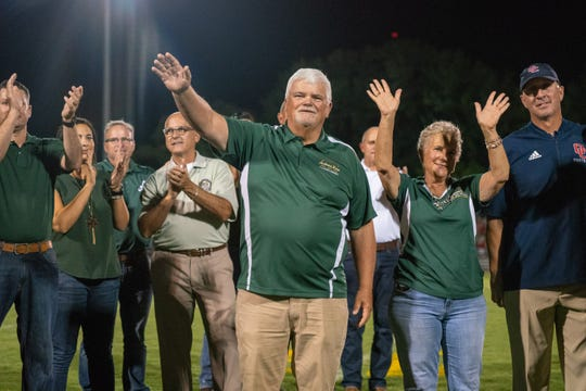 Former Acadiana High head football coach Ted Davidson waves the Rams' faithful during the field dedication in his name.