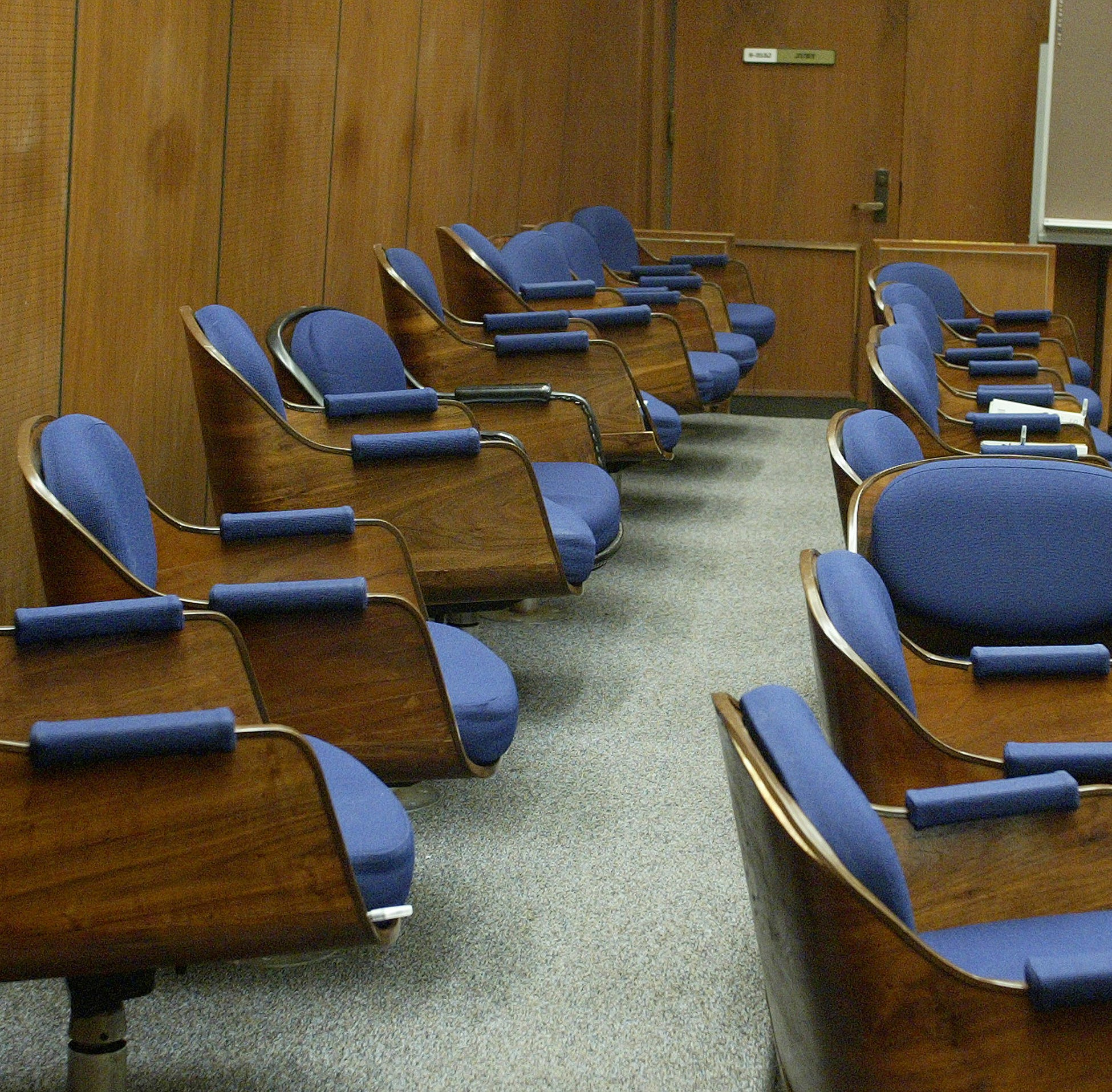 Seats in an empty jury box. (Photo by Fred Prouser-Pool/Getty Images)