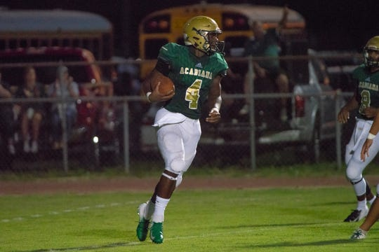 Acadiana's Lucky Brooks (4) scores a touchdown for his team as the Comeaux Spartans take on the Acadiana Wreckin' Rams at Acadiana High School on Oct. 5, 2018.