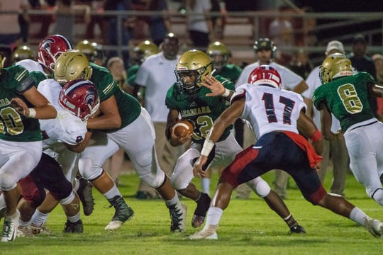 Acadiana's Larryll Greene runs through the defense as the Comeaux Spartans take on the Acadiana Wreckin' Rams at Acadiana High School on Oct. 5, 2018.
