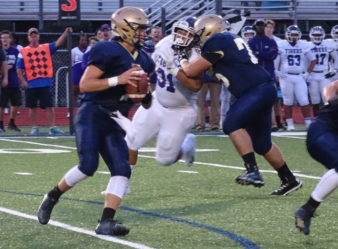Lancaster senior quarterback Tyler Monk sets up to pass against Pickerington Central Friday night at Fulton Field. The Golden Gales pulled off a huge upset, defeating the Tigers, 31-30.