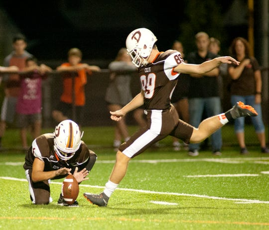 DeSales running back Shawn Kaufman holds for DeSales place kicker Blake Givens who gives DeSales a field goal for their first score of the game. Oct. 5, 2018