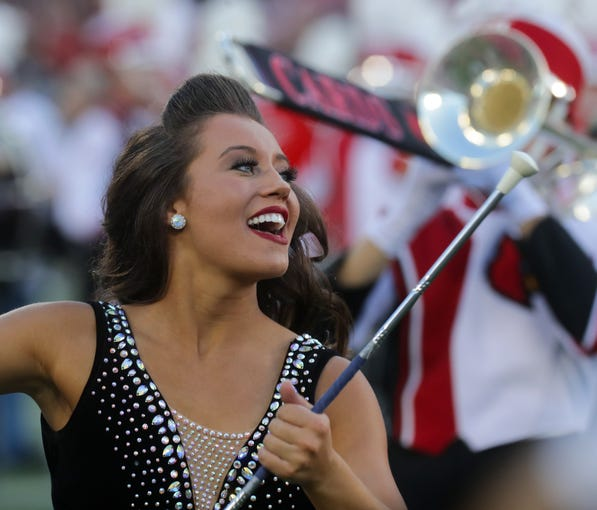 The Cardinal Marching Band Feature Twirler Steffany Lien performs before the game.  