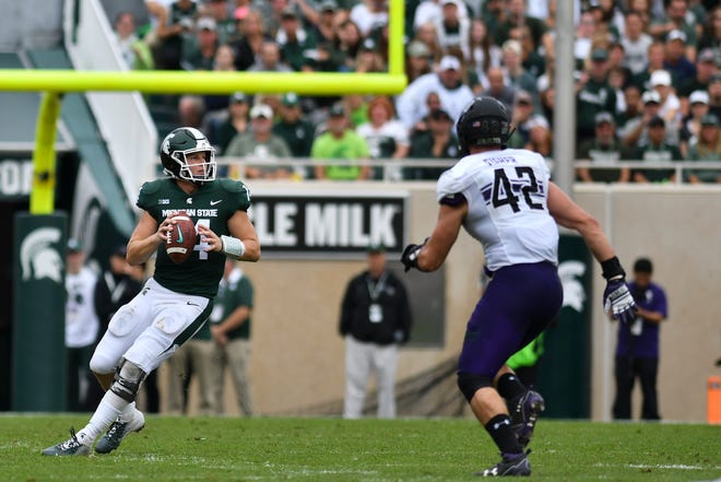 Brian Lewerke throws against Northwestern Saturday, Oct. 6, 2018.