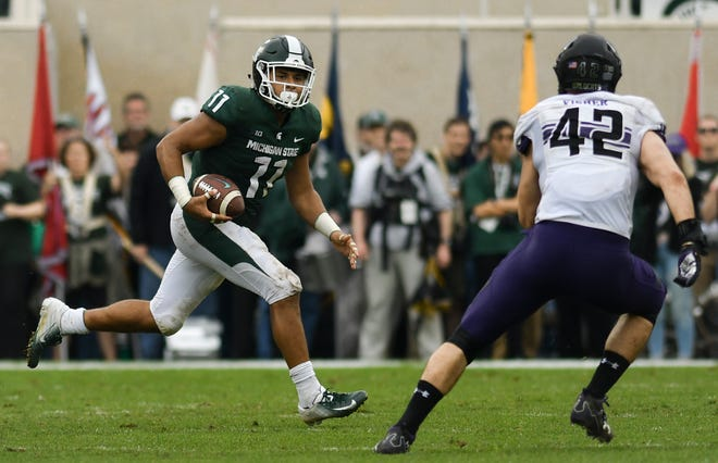 MSU's Connor Heyward moves the ball against Northwestern's  Paddy Fisher.