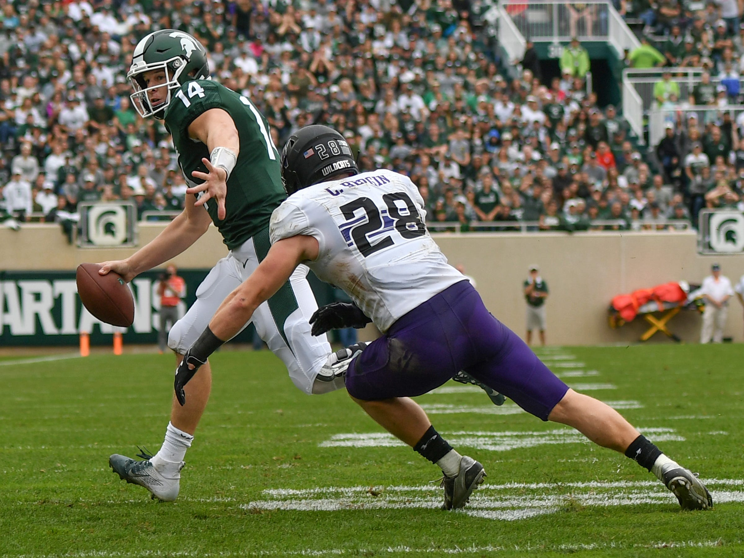 MSU QB Brian Lewerke tries to get past Chris Bergin on a keeper, Sat., Oct. 6, 2018.  MSU lost 29-19.