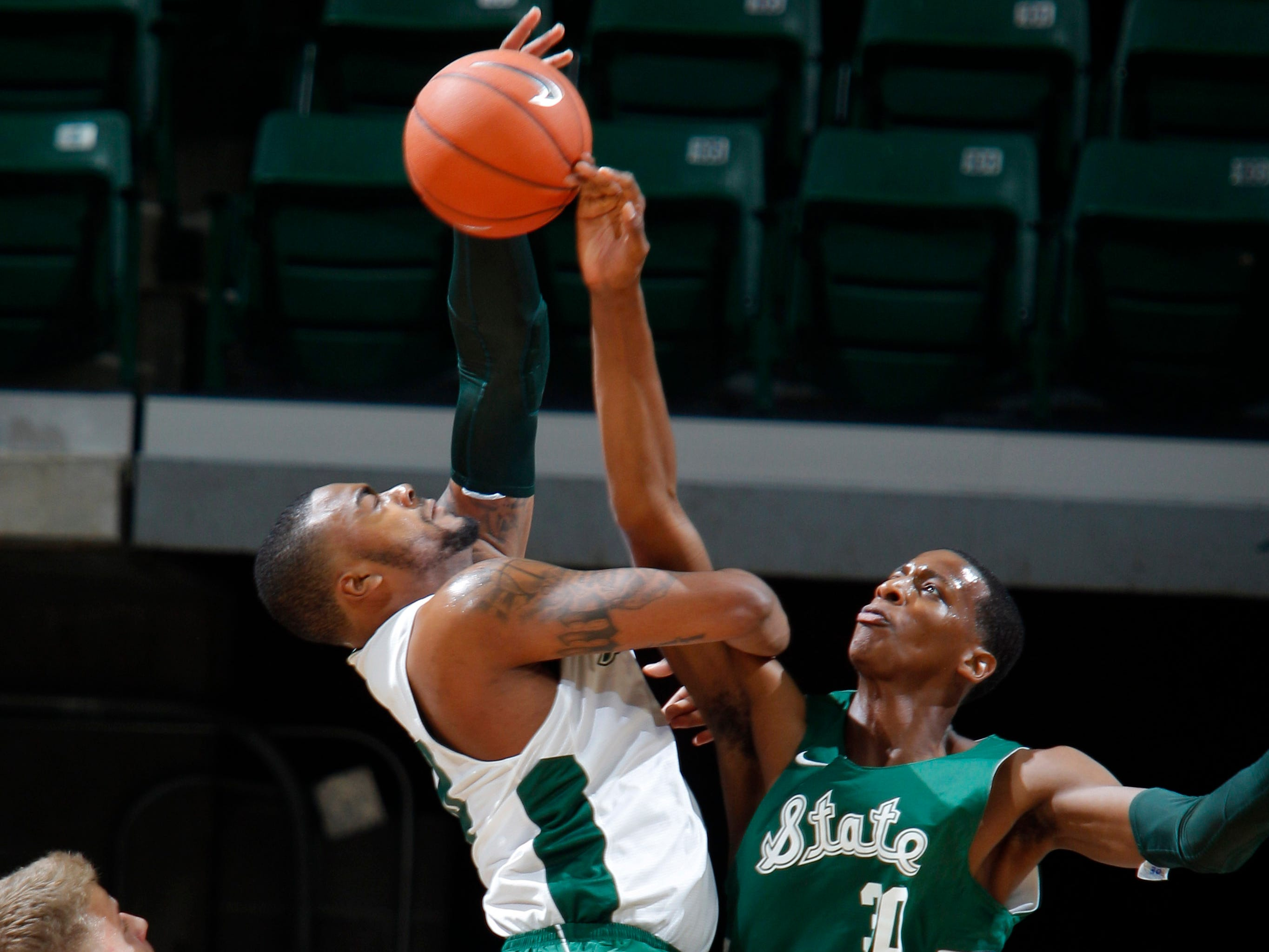 Michigan State's Marcus Bingham Jr., right, blocks a shot by Nick Ward at MSU Madness, Saturday, Oct. 6, 2018, in East Lansing, Mich.