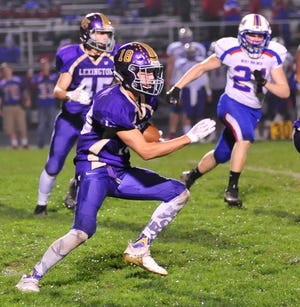 Lexington's Alex Green runs down the field while playing against West Holmes on Friday night.