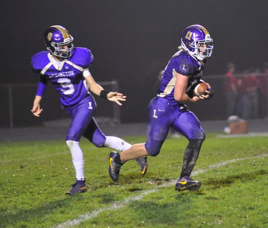 Lexington's Jake Depperschmidt makes a pass to Kayden Berry while playing against West Holmes earlier in the season.