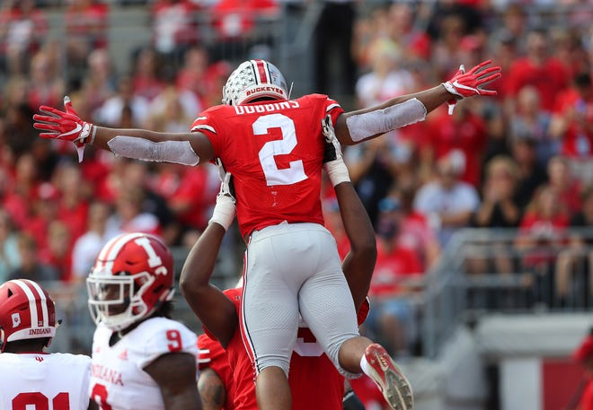 Ohio State tailback J.K. Dobbins celebrates with tackle Isaiah Prince after scoring a first quarter touchdown.