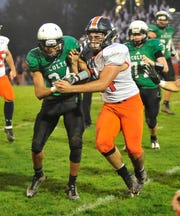 Clear Fork's Tacoma Orr spars with Galion's John Abouhassen on Friday night.
