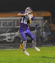 Lexington's Alex Green makes a catch while playing against West Holmes in Week 7.