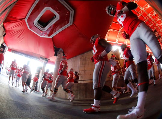 The Ohio State Buckeyes charge out of the tunnel for Saturday's Big Ten battle with Indiana.
