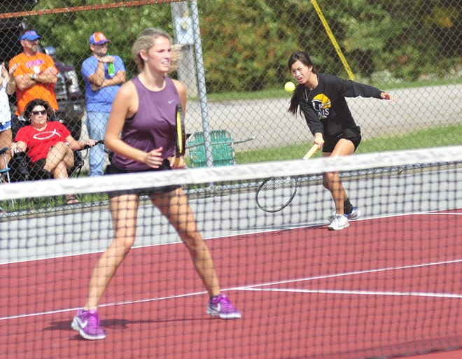 Lexington's Sylvia Goldsmith, left, and Gracie Pfieffer didn't lose a game in Saturday's finals en route to a Division II sectional tennis doubles title