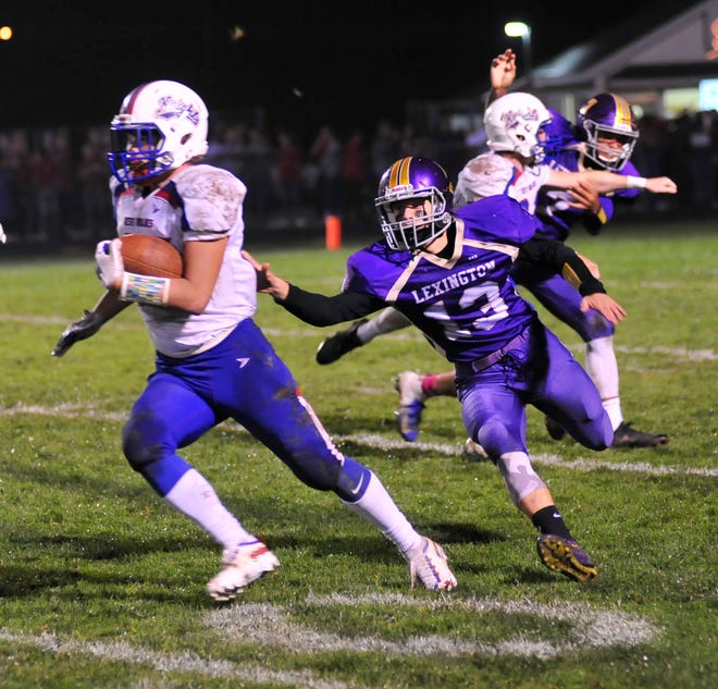 Lexington's Brayden Stoots attempts a tackle while playing against West Holmes in Week 7.