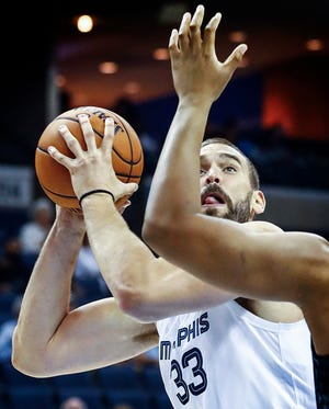 Memphis Grizzlies center Marc Gasol puts up a shot against the Atlanta Hawks defense during first quarter action at the FedExForum in Memphis, Tenn., Friday, October 5, 2018.