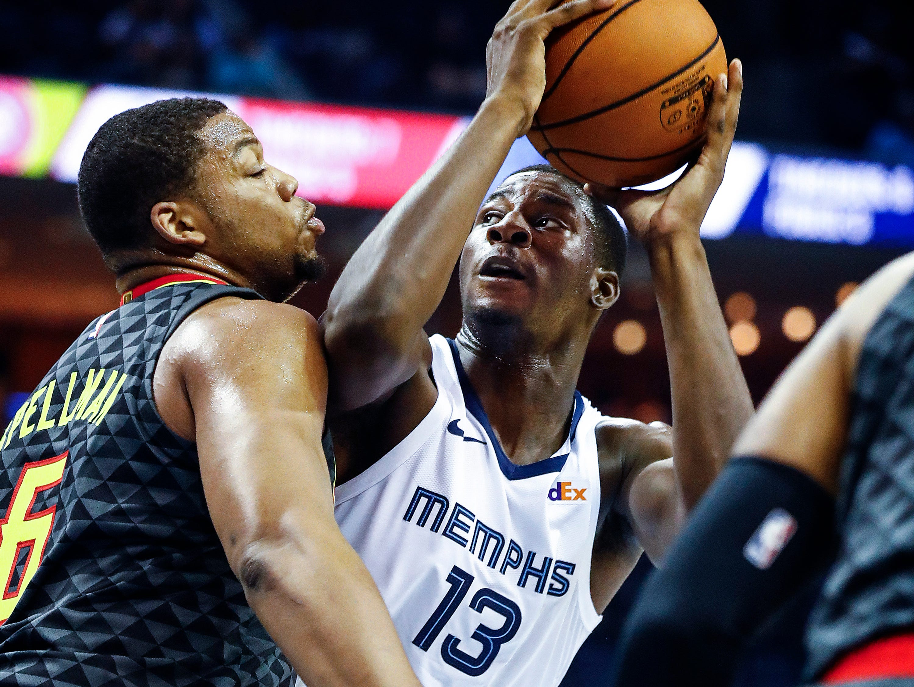 Memphis Grizzlies rookie Jaren Jackson Jr. (right) drives the lane against Atlanta Hawks defender Omari Spellman (left) during first quarter action at the FedExForum in Memphis, Tenn., Friday, October 5, 2018.