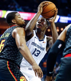 Grizzlies rookie Jaren Jackson Jr. (right) drives the lane against the Hawks' Omari Spellman (left) during a preseason game Oct. 5.