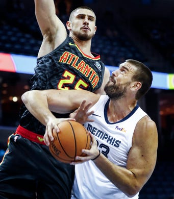 Memphis Grizzlies center Marc Gasol (bottom) is fouled by Atlanta Hawks defender Alex Len (top) during first quarter action at the FedExForum in Memphis, Tenn., Friday, October 5, 2018.