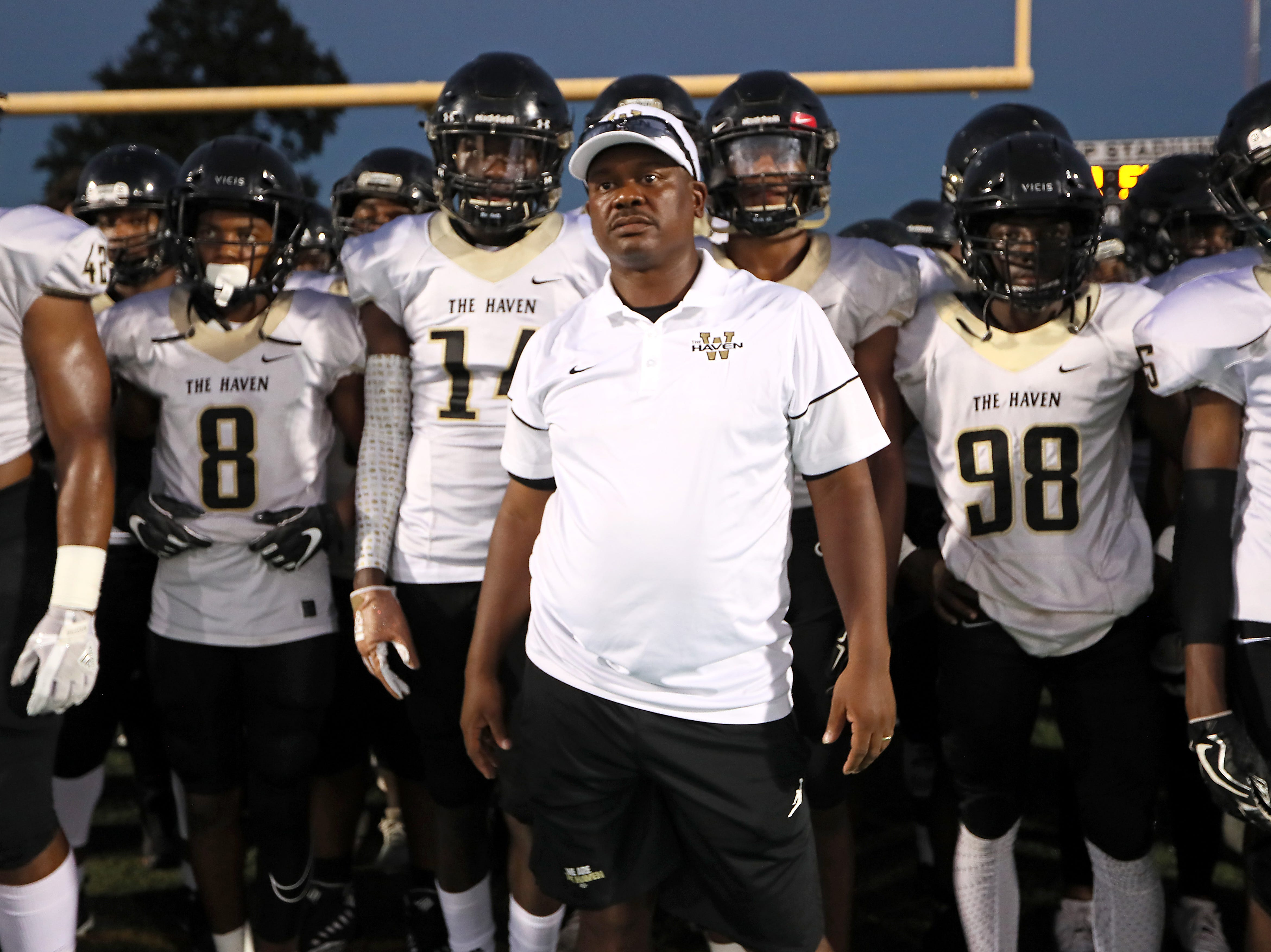 Whitehaven Head Coach Rodney Saulsberry prepares to lead his team out on to the field for their game at Memphis Central High School on Friday, Oct. 5, 2018.