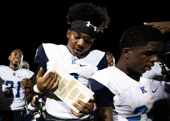Kirby QB Jaden Johnson holds the trophy after the Cougars  33-14 victory over the Southwind Jaguars Friday October 5, 2018. The Cougars are now making them 7-1.