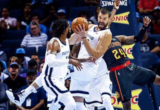 Memphis Grizzlies Marc Gasol (middle) grabs a rebound against the Atlanta Hawks during second quarter action at the FedExForum in Memphis, Tenn., Friday, October 5, 2018.