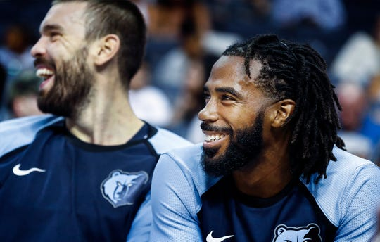 Memphis Grizzlies teammates Marc Gasol (left) and Mike Conley (rihgt) during first quarter action against Atlanta Hawks at the FedExForum in Memphis, Tenn., Friday, October 5, 2018.