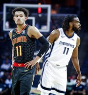 Memphis Grizzlies guard Mike Conley (right) and Atlanta Hawks defender Trae Young (left) during first quarter action at the FedExForum in Memphis, Tenn., Friday, October 5, 2018.