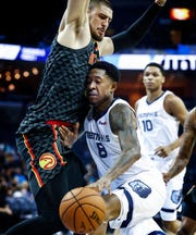 Memphis Grizzlies guard MarShon Brooks (right) drives the lane against Atlanta Hawks defender Alex Len (left) during first quarter action at the FedExForum in Memphis, Tenn., Friday, October 5, 2018.