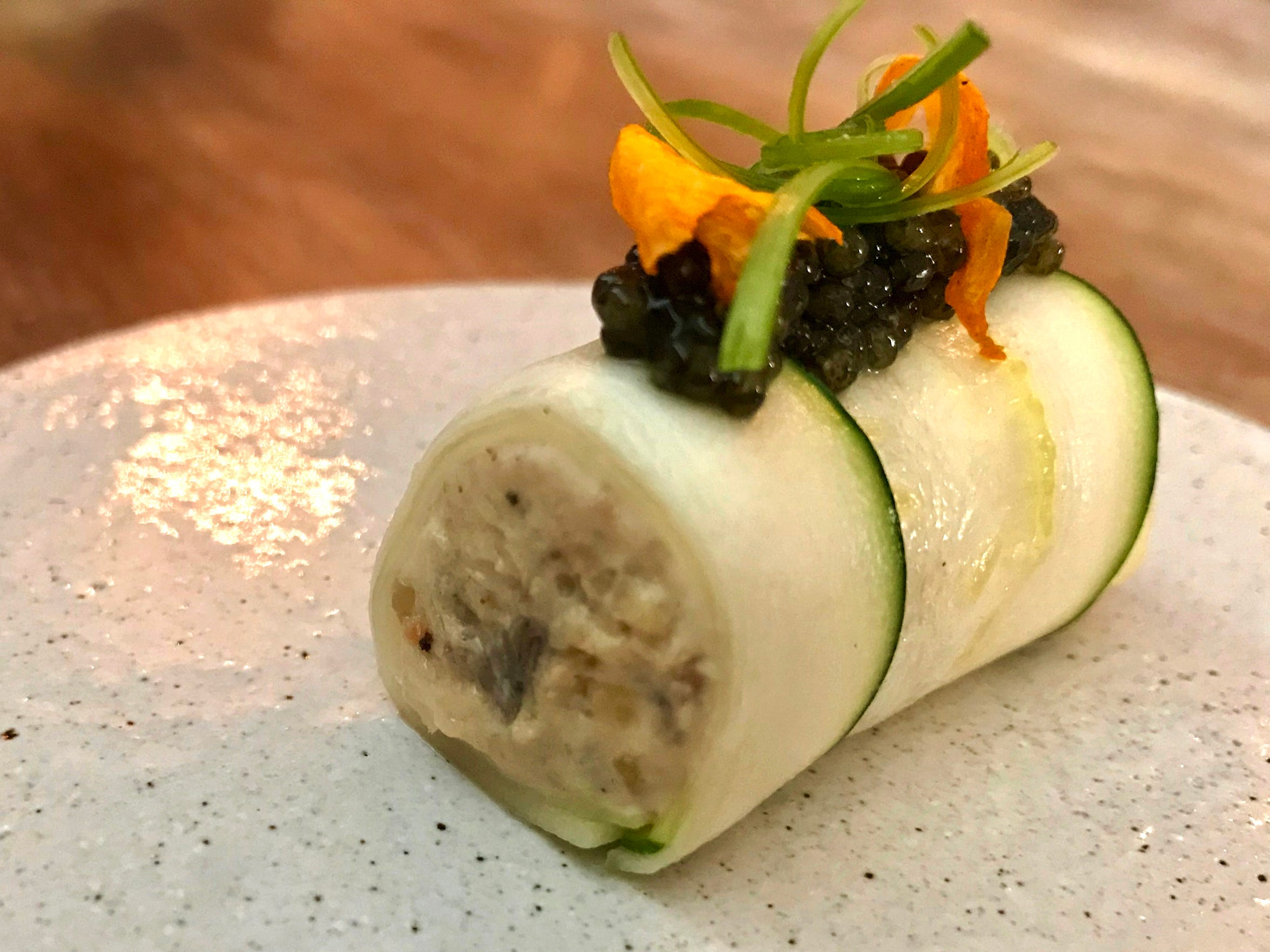 Caviar tops a creamy cylinder of eel that's wrapped in a thin slice of zucchini, one of the courses on the late-summer tasting menu at Ardent, 1751 N. Farwell Ave.