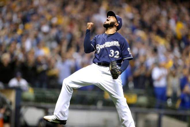 A joyous Jeremy Jeffress pumps his fist after recording the final out of the Brewers' 4-0 Game 2 victory over the Rockies in the teams' NL Division Series on Friday at Miller Park.