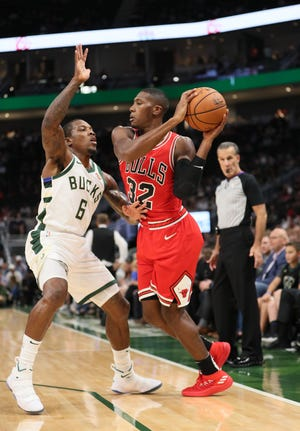 Bucks guard Eric Bledsoe plays tight defense on the Bulls' Kris Dunn on Wednesday. Coach Mike Budenholzer has been stressing the fundamentals of playing defense during preseason camp.