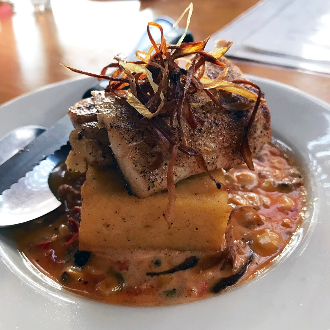 The trout Creole at the global share-plates restaurant La Merenda, 125 E. National Ave., puts local fish with New Orleans flavors: house-made andouille sausage and the sweet-corn dish maque choux.