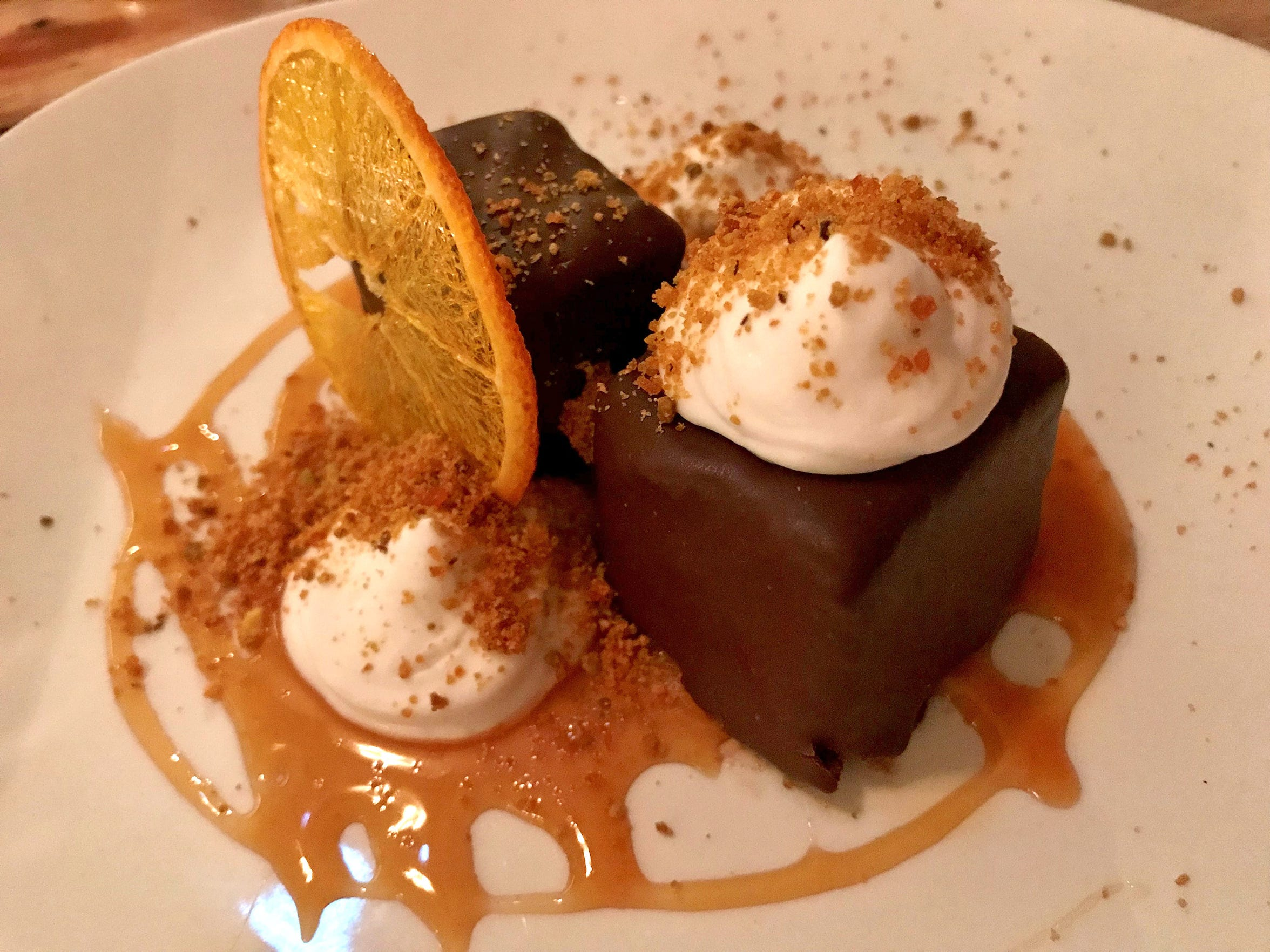 From the changing lineup of desserts at Odd Duck, 2352 S. Kinnickinnic Ave.: chocolate ganache cake with coconut foam, caramel and pistachio-praline dust.