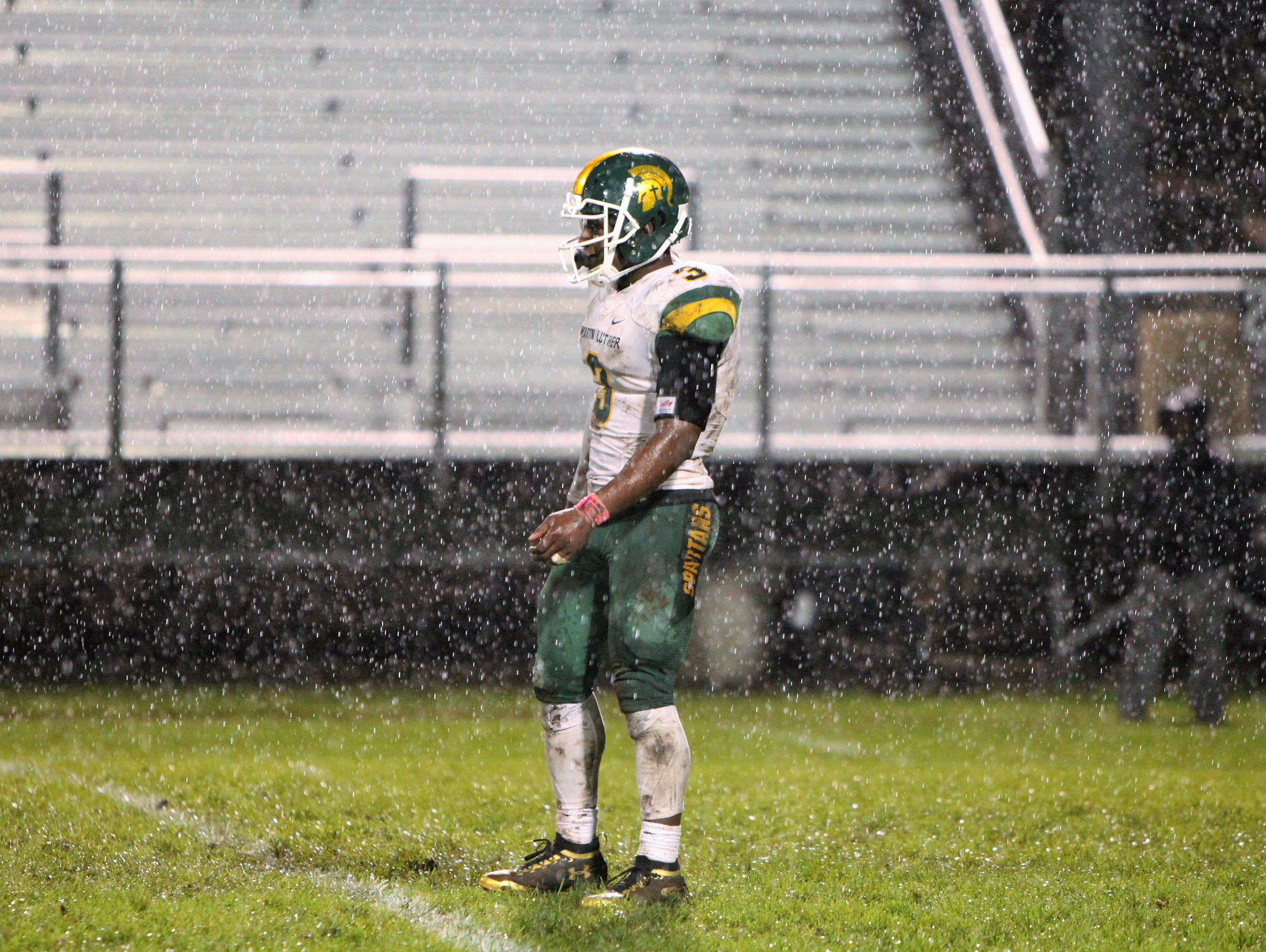 Martin Luther senior Darios Crawley-Reid awaits a kickoff in the rain against Racine St. Catherine's on Oct. 5, 2018.