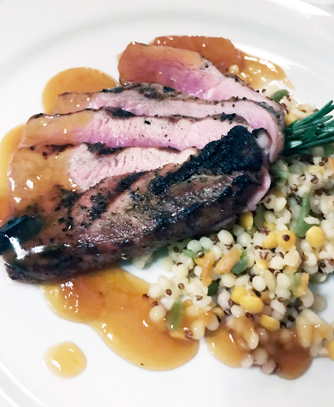 At Sebastian's, 6025 Douglas Ave., Caledonia,  rosy grilled duck breast was sliced and served with orange gastrique and a pasta-quinoa pilaf.